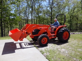 My Dad, Chuck Gore, on his new toy. He has cleared about 5 acres of forest around the house just with a chain saw. All at age 80+