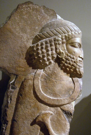 The curled hair and beard of the Persian General. British Museum