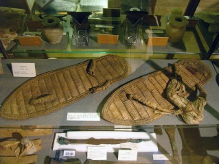 Isis would never have the worn plain sandals of a common Egyptian. Petrie Museum